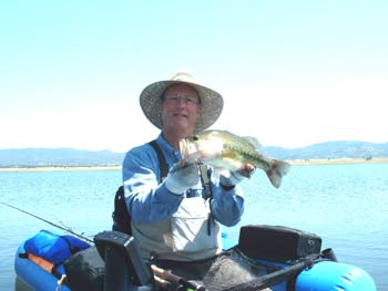 David Harris holding bass on Salt Springs Valley Reservoir