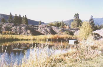 pond with pram and tailings background