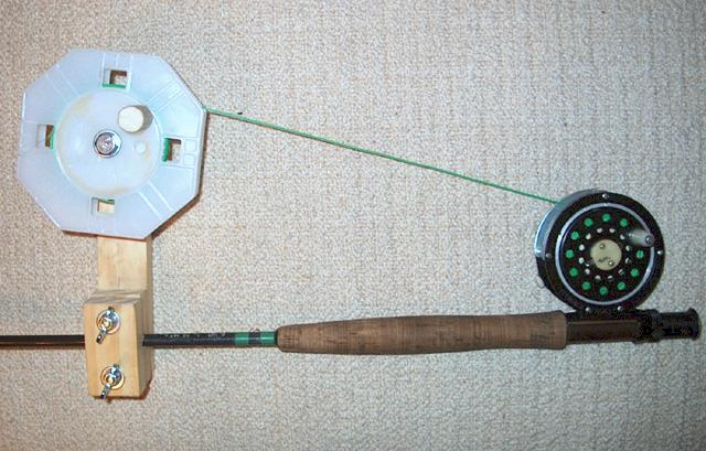 side view of line winder attached to fly rod with reel