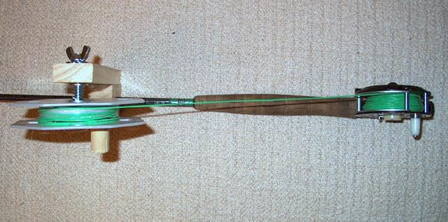 top view of line winder attached to fly rod with reel